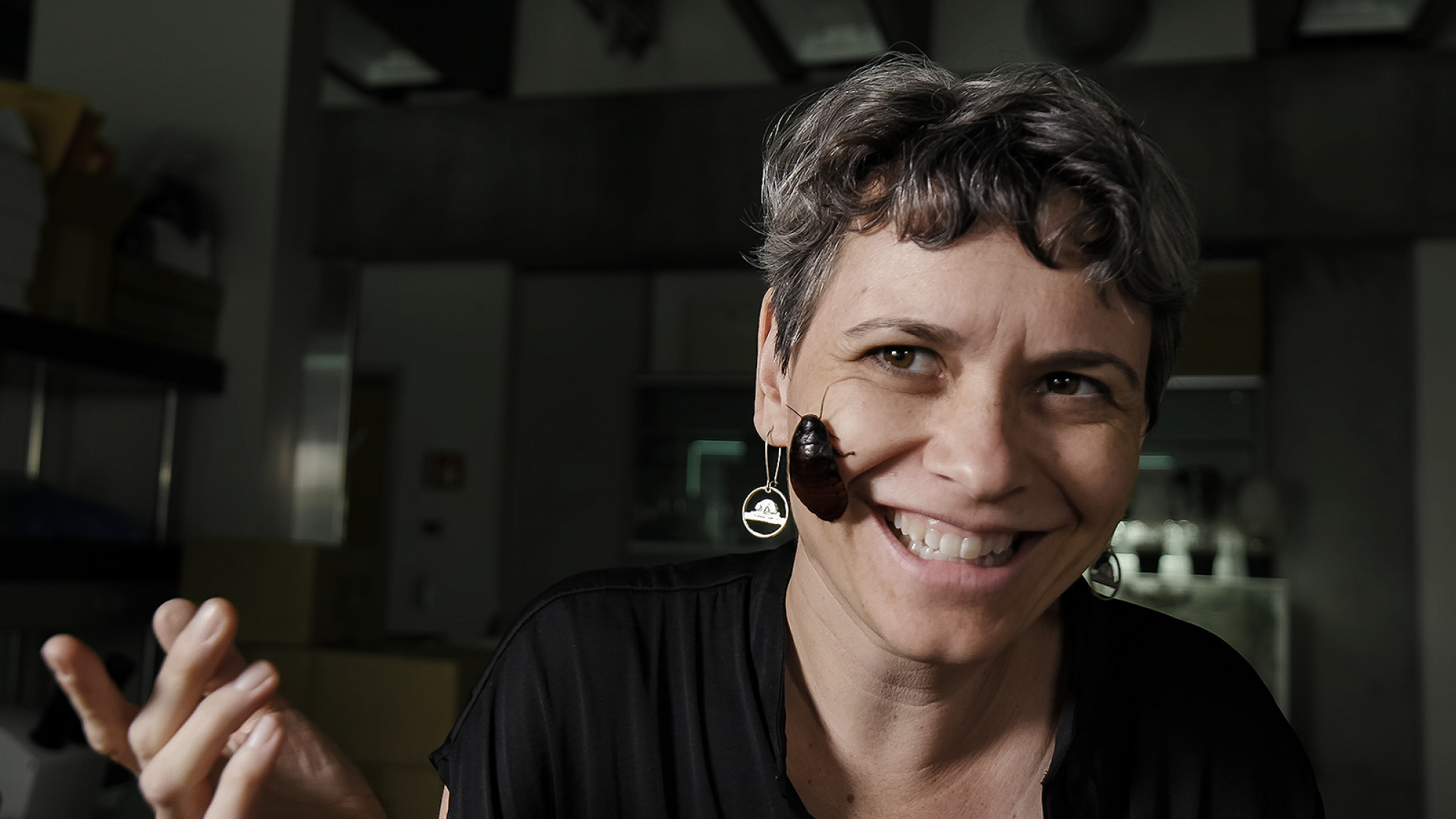 smiling woman with bug on her face